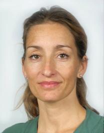 Profilbild på Johnna Sahlsten Schölin. Johnna är klädd i grön tröja.