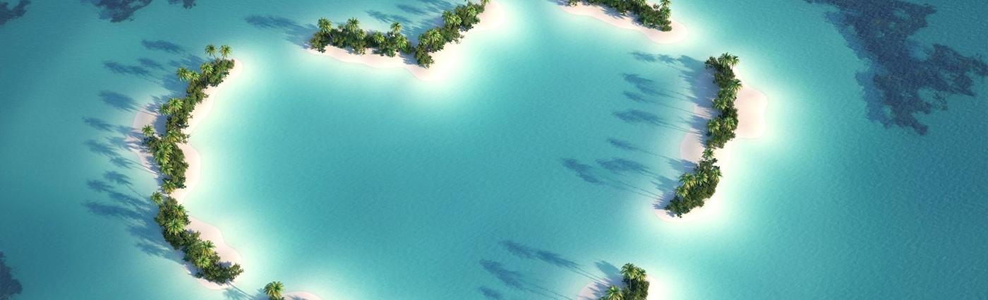 Stilla havs-atoller i klarblått vatten.