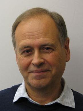Profilbild på registerhållare Lars Gahnberg iförd blå tröja och vit skjorta.