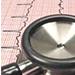 Stetoskop ovanpå hjärtrytmsdiagram.